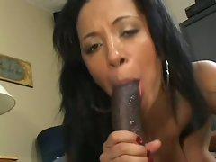 Sassy Misti Love slurps on this chocolate lolly cock
