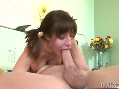 Voluptuous whore chokes on a massive throbbing boner