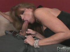 Darla Crane slurps on a massive cock like a giant stiff noodle