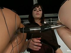 Nasty femdom Bobbi Starr wires up these two's pussy