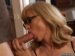 Scorching Nina Hartley slobbers on this meat pole
