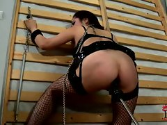 Chained up bitch gets her tight pussy machine fucked