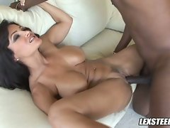 The fingers of Lisa Ann pull apart her cunt lips to welcome a fat dick.