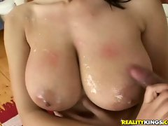 Busty brunette Jane giving a hot handjob and getting her tits jizzed on