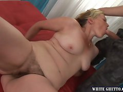 Blonde MILF wraps her lips and her hairy snatch around a huge dick