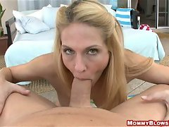 Slutty momma Angela Attison filling her wet mouth with massive cock