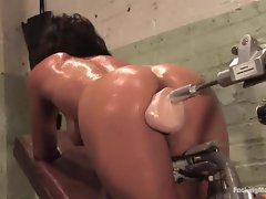 Hot and sexy Charley Chases oiled up pussy hammered by fat dildo fucking machine