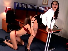 Office slut Eve Angel tonguing boss on desk