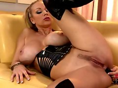 Busty bitch rams her favorite dildo deep in her asshole