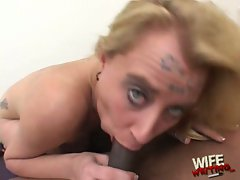 Deepthroating whore Miss Dee gags on a long black dong