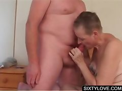 Sixty lady giving blowjob in bedroom