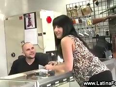 Latina seducing at a gun store
