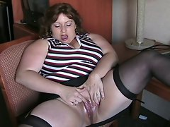 BBW in stockings masturbating in hotel room