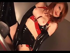 Redhead in Latex gloves, stockings and high heel boots