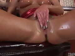 Blonde babe all oiled up fisting her own part1