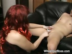 Redhead femdom in black leather boots tortures a submissive guys cock