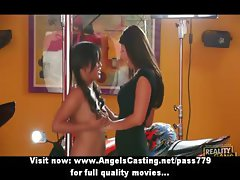 Sexy brunette lesbian couple dancing and undressing in a car dealerships