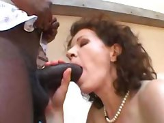 Mature chick with big boobs gets her hairy cunt filled with black cock