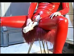Tied up slave girl posing in latex
