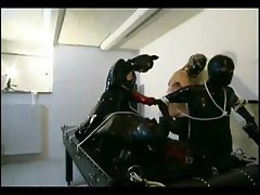 Two dominaas in latex having fun