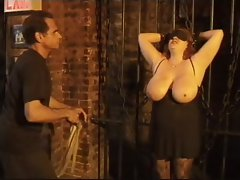 Fat girl in bondage has her tits whipped