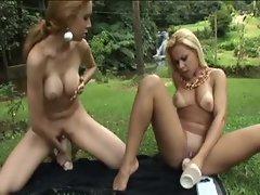 Brazilian girls with big dildos fuck outdoors