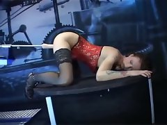 Skinny chick in a corset loves dildo machine