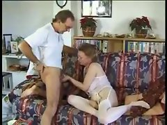 His mature wife strokes and sucks his dick
