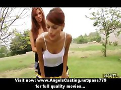 Sporty young lesbian schoolgirls kissing and licking tits outdoors