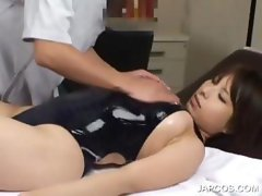 Asian in swim suit getting hot body massaged