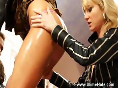 Horny russian lesbians put their strapons to full use and get loads of semen all over their body