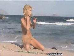 Blonde girl at the beach strips