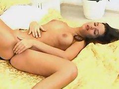 She slowly and sensually masturbates her pussy