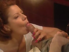 Busty redhead in a short skirt foreplay