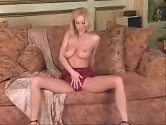 Slim blonde in red lace lingerie uses a blue toy