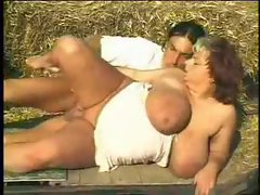 He sucks on her BBW tits outdoors