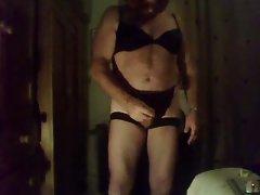Fat crossdresser jerks off into condom