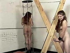 Bound girl in a collar is abused hard