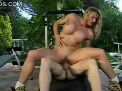 Muscular girl with fake tits fucked outdoors