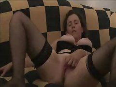 Busty and on the couch rubbing her clit