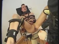 Totally bound guy penetrated by girl
