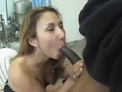 She sits outdoors and sucks a dark dick