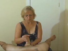 Mature with skills gives POV handjob