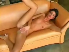 Sexy girl in a skimpy dress plays