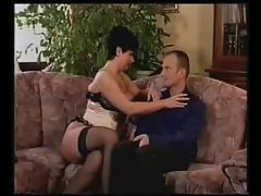 Gal in corset feeds him her tits