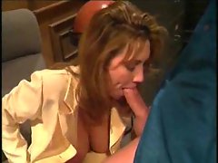 Milf on her knees performing oral sex