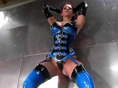 Latex outfit babe poses solo with big tits