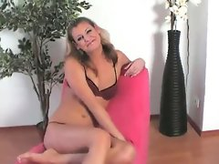 Young blonde plays with tits and pussy