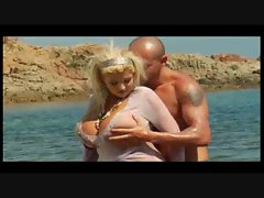 Huge titty blonde fucked on sexy beach