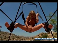 Beautiful babes fingering their pussies in a sex swing